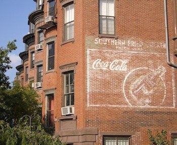 South End neighborhood brownstones with advertisement for Coca-Cola or Coke