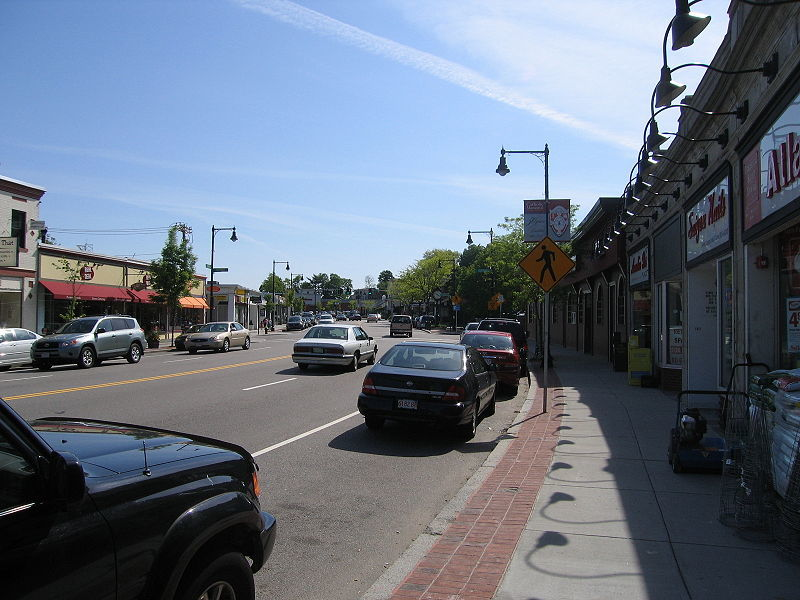 A busy West Roxbury MA street with shops and restaurants
