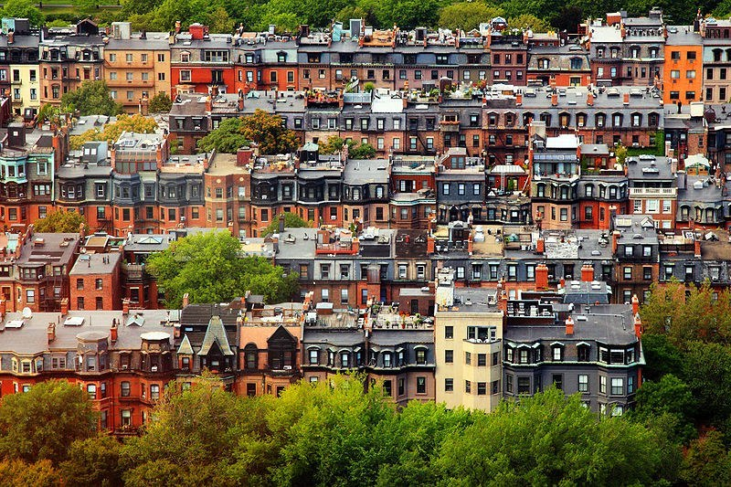 Aerial view of rows of brownstone homes in Boston's Back Bay.